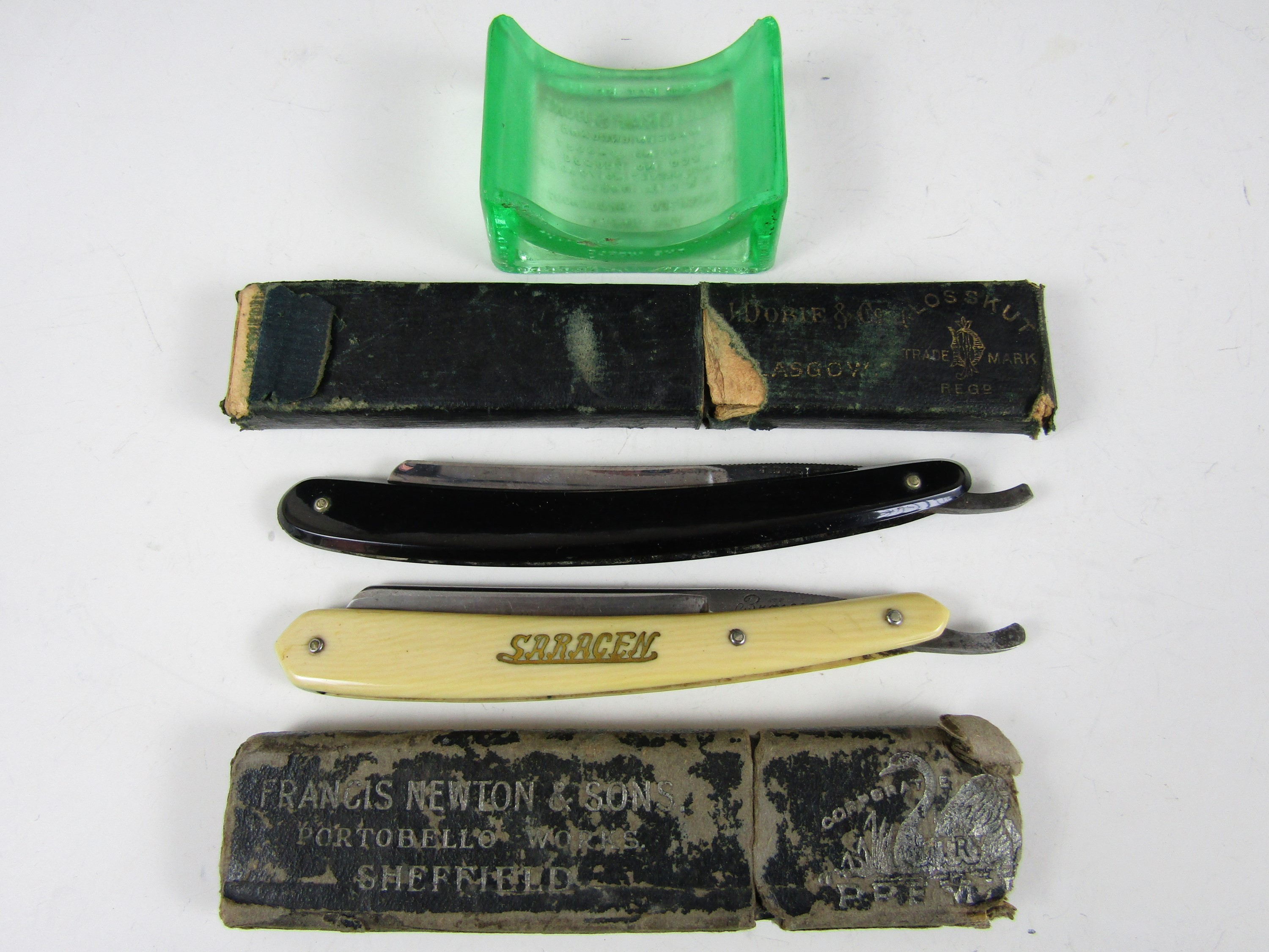 Lot 36 - Two cased vintage cut-throat razors including a J. Dobie and Co Klosskut and a German Saragen