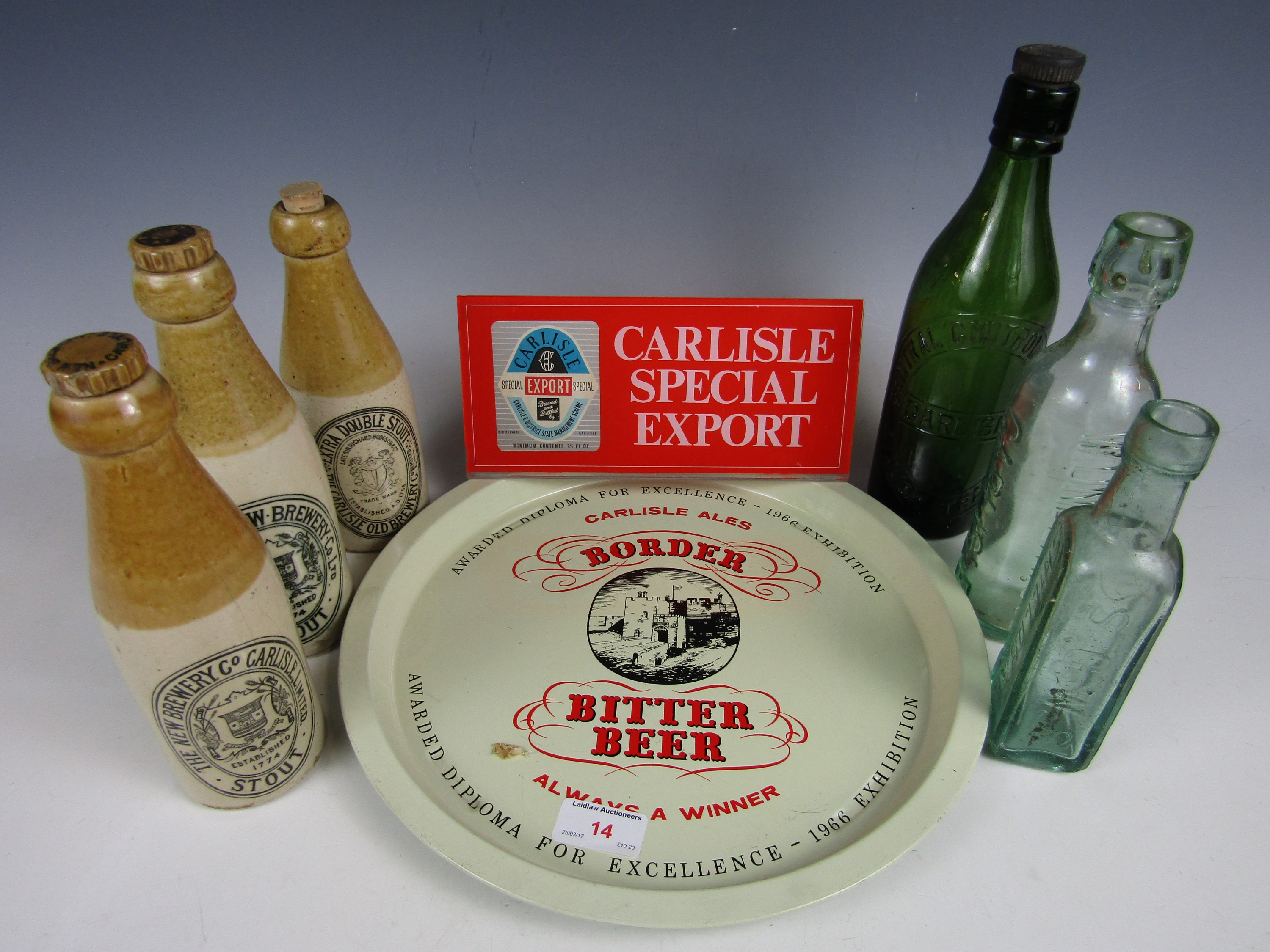 Lot 14 - A Carlisle Ales plaque together with a tray, three stoneware bottles and three glass bottles