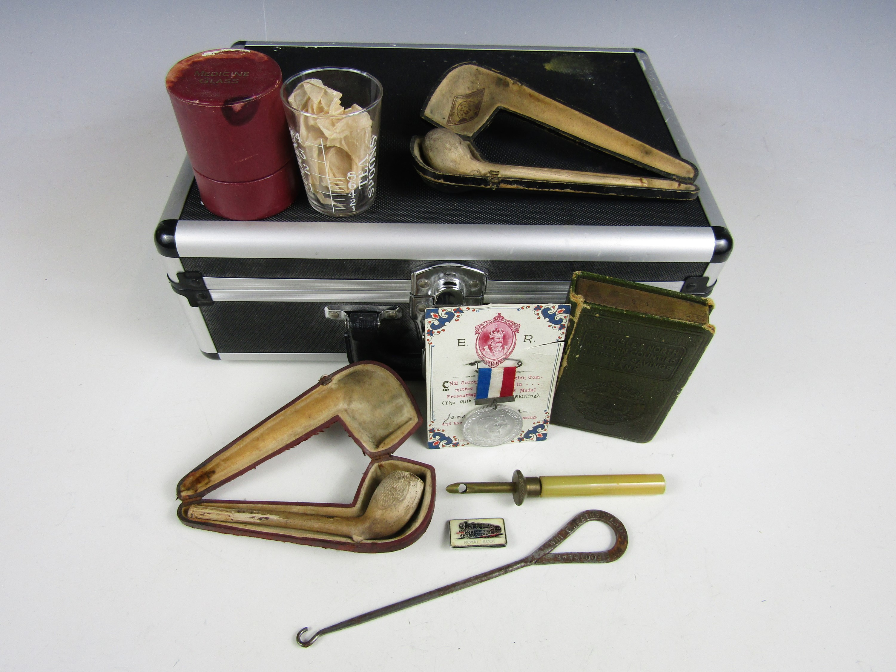 Lot 21 - Sundry collectors' items including a protector case, a vintage medicine glass and two meerschaum