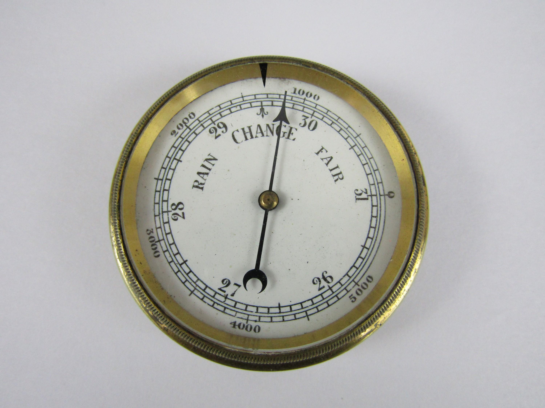 Lot 29 - A vintage pocket barometer