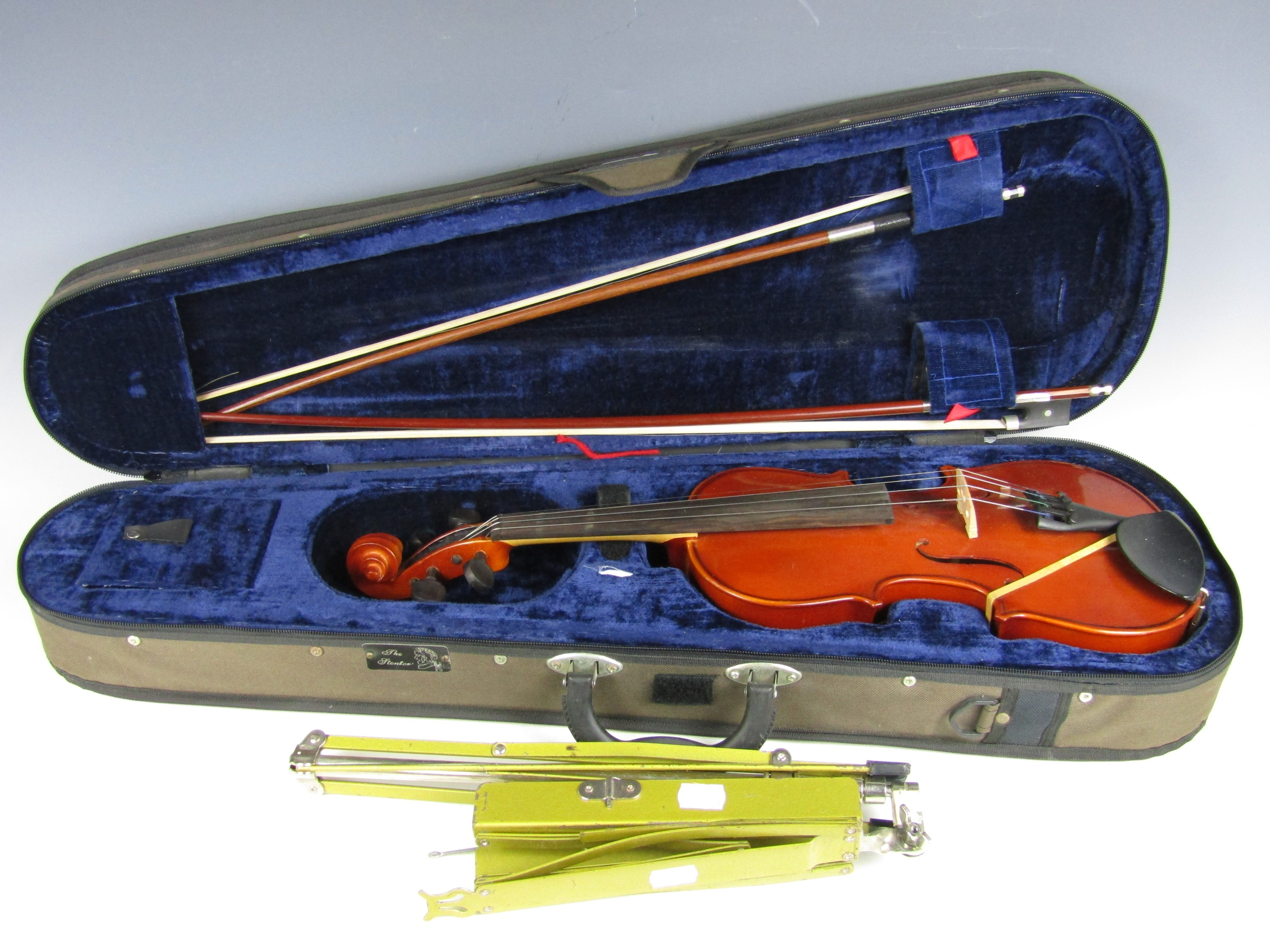 Lot 47 - A cased Stentor Student II violin together with two contemporary bows and a music stand