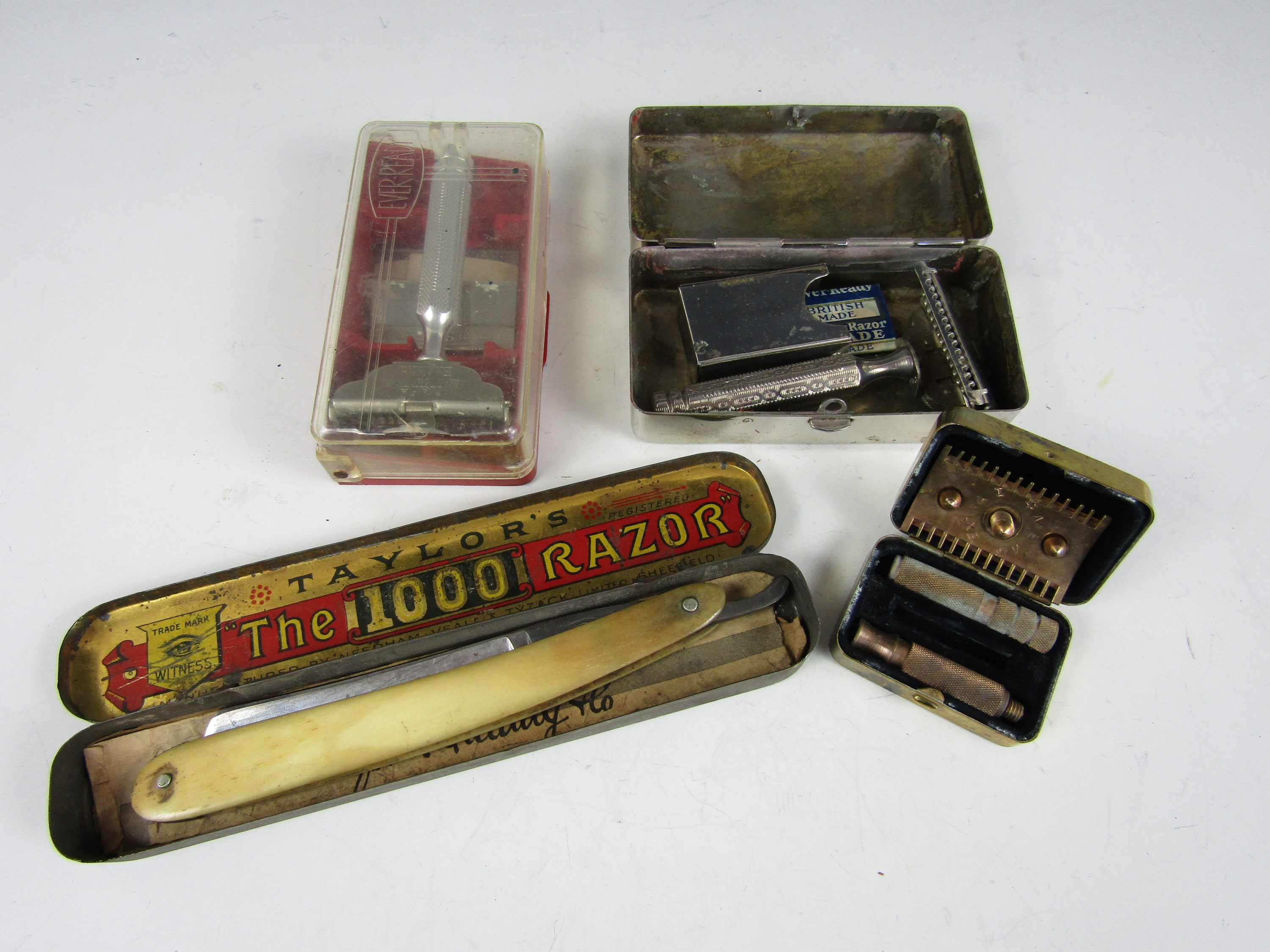 Lot 18 - A vintage Ever Ready razor together with The 1000 Razor and two others