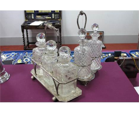 A Plated Three Bottle Decanter Stand, of plain rectangular form, fitted with three associated matched cut glass stoppered dec