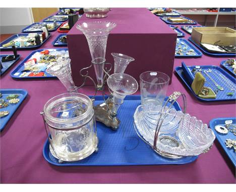A Plated Four Flute Epergne, overall height 32cm; together with a decorative cut glass and plated swing handled dish (glass d