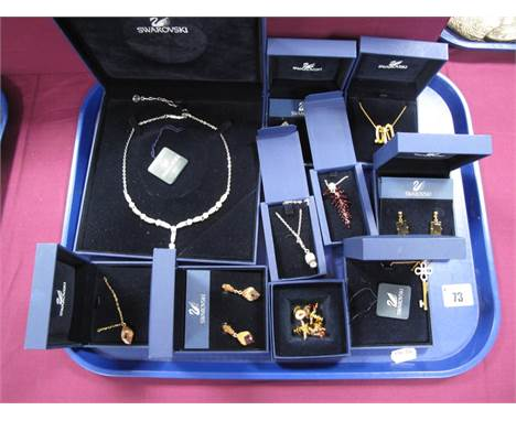 Swarovski; A Collection of Costume Jewellery, including ornate necklaces, drop earrings, decorative pins/badges, including si