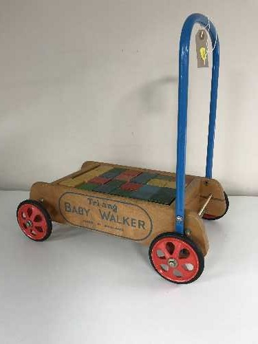 Lot 8 - A vintage Triang baby walker