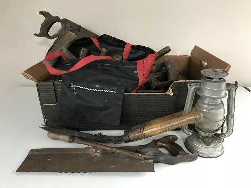 Lot 19 - A box of vintage hand tools, garden tools, Tilly lamp,