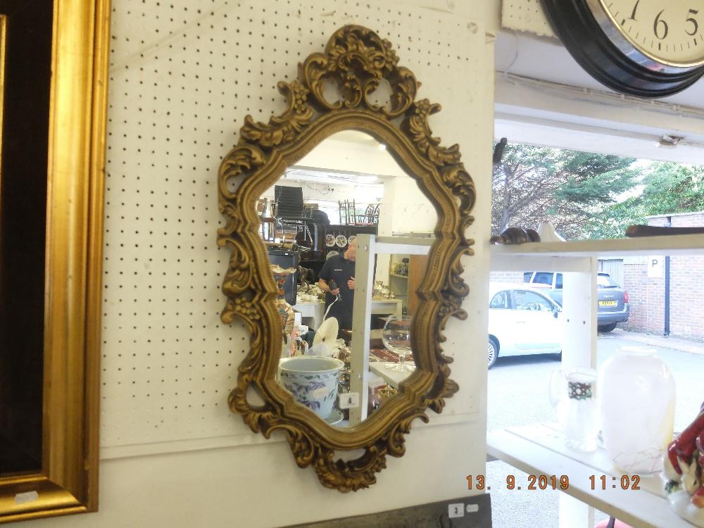 Lot 4 - A gilt framed mirror