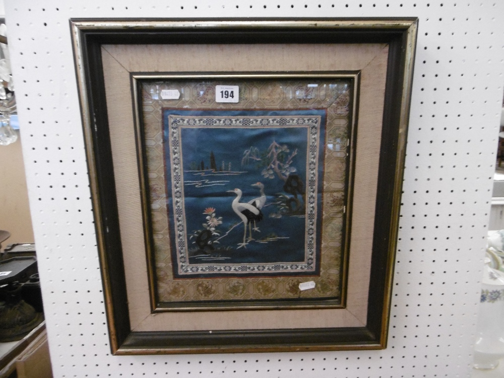 Lot 285 - A framed Japanese silk embroidery of herons circa 1900