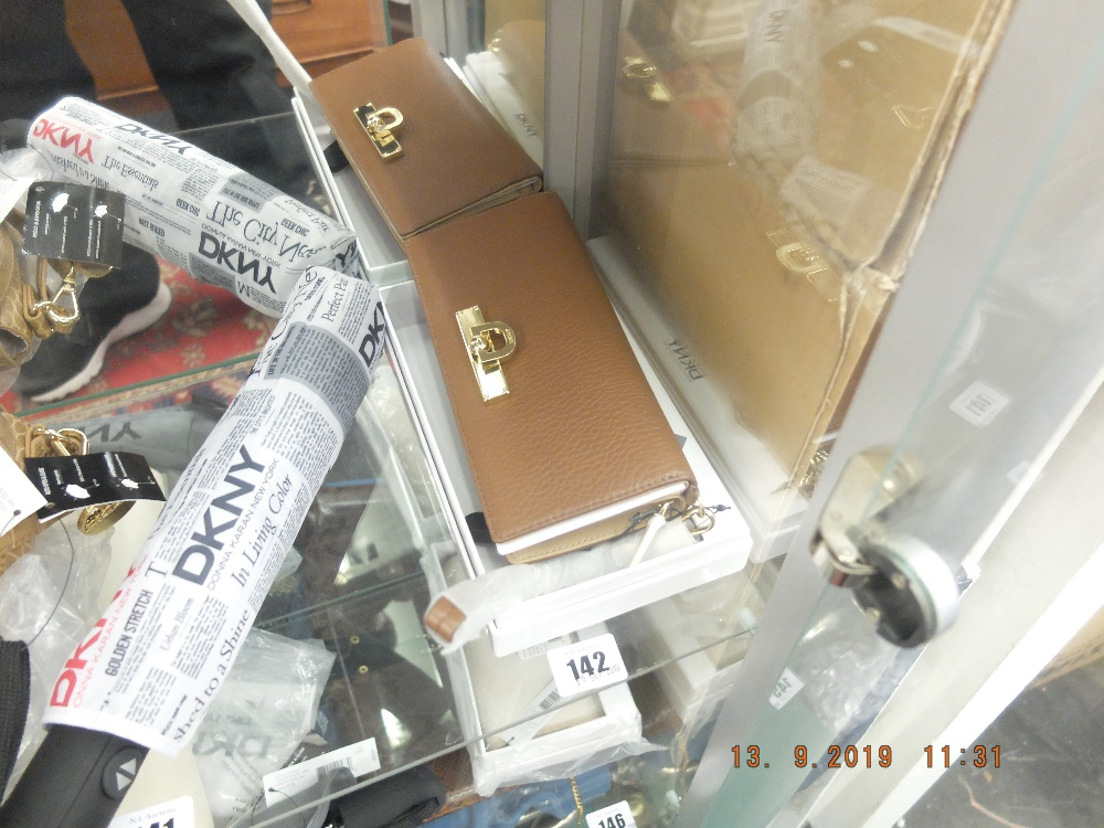 Lot 142 - A DKNY purse - colour- Luggage in leather, code: 215, brand new unused, still has labels etc.