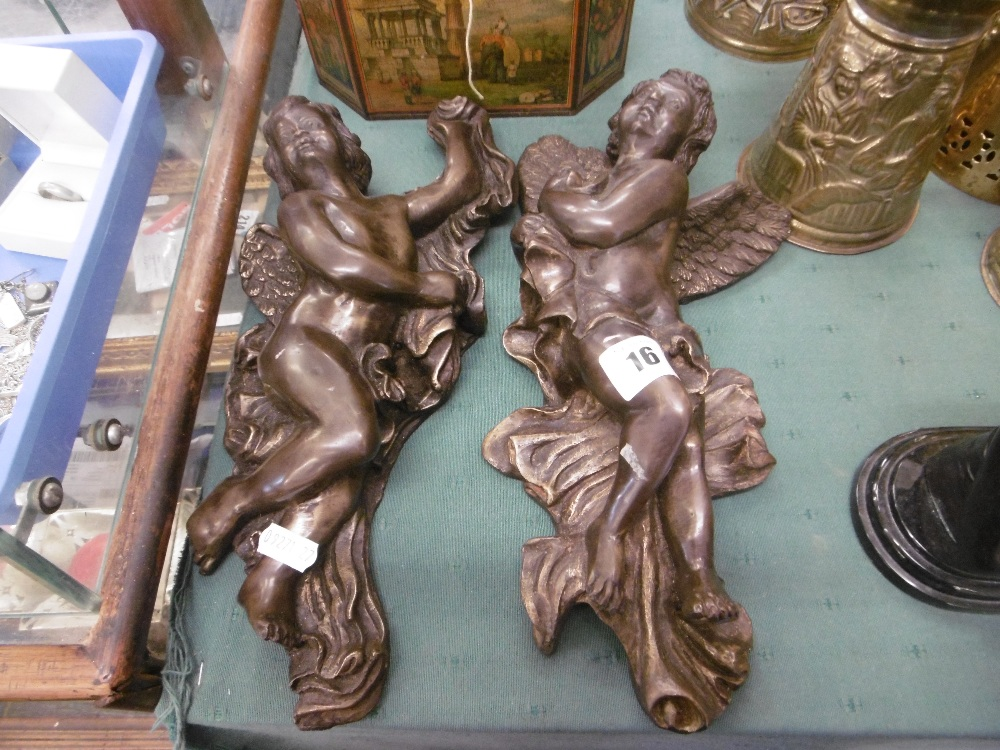 Lot 113 - A pair of bronze wall cherubs