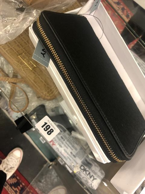 Lot 138 - A DKNY black purse, brand new unused, still has labels etc.