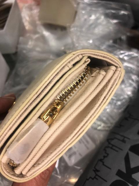 Lot 144 - A DKNY purse- colour- Hemp, leather, brand new unused,