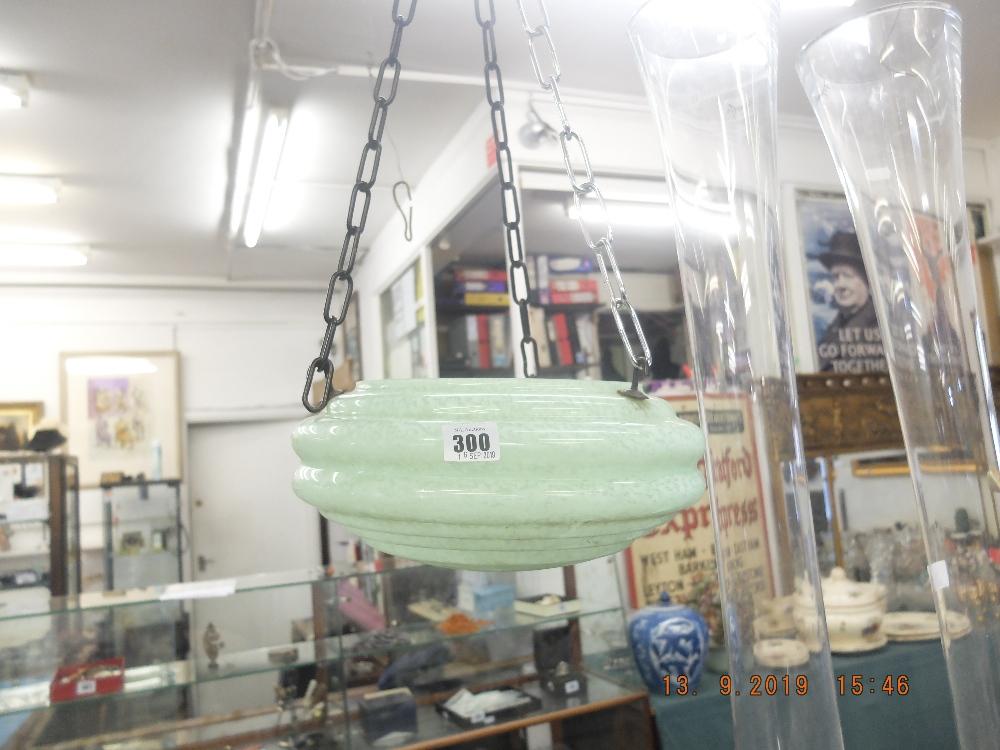 Lot 300 - An art deco jade green glass bug catcher