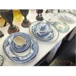 A mixed quantity of chinaware including platters
