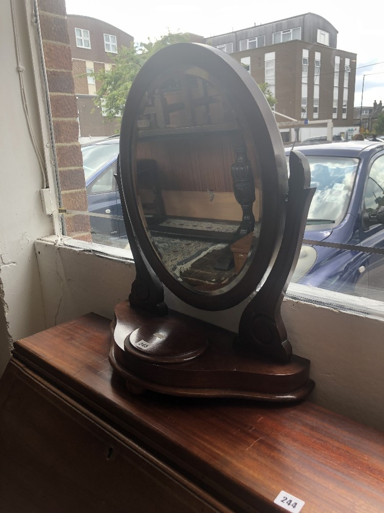 Lot 321 - A mahogany swing toilet mirror