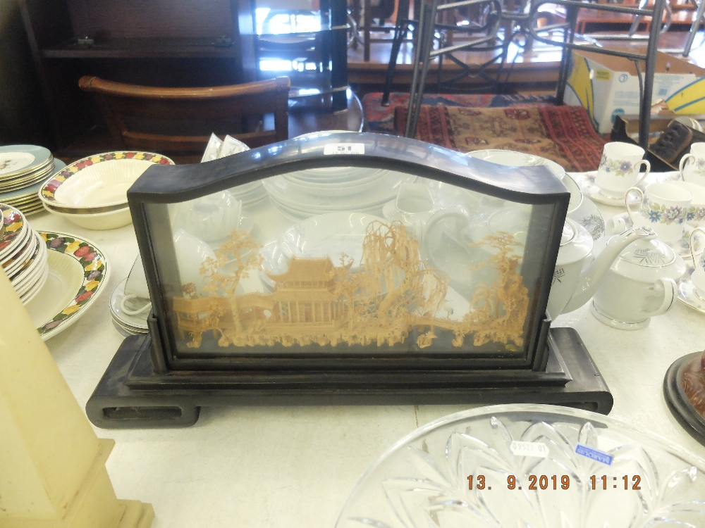 Lot 51 - An oriental cork sculpture in a hardwood frame