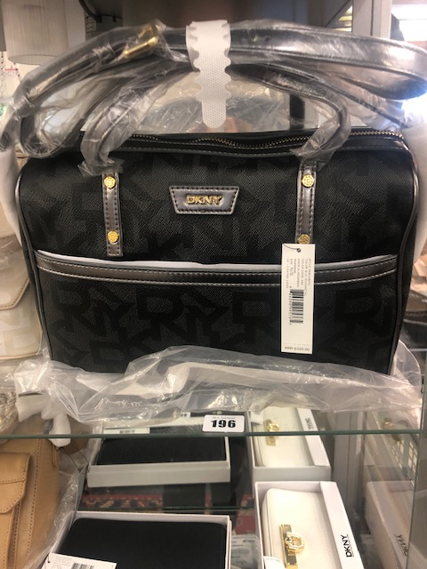 Lot 136 - A DKNY black and gun metal handbag, brand new unused, still has labels etc.