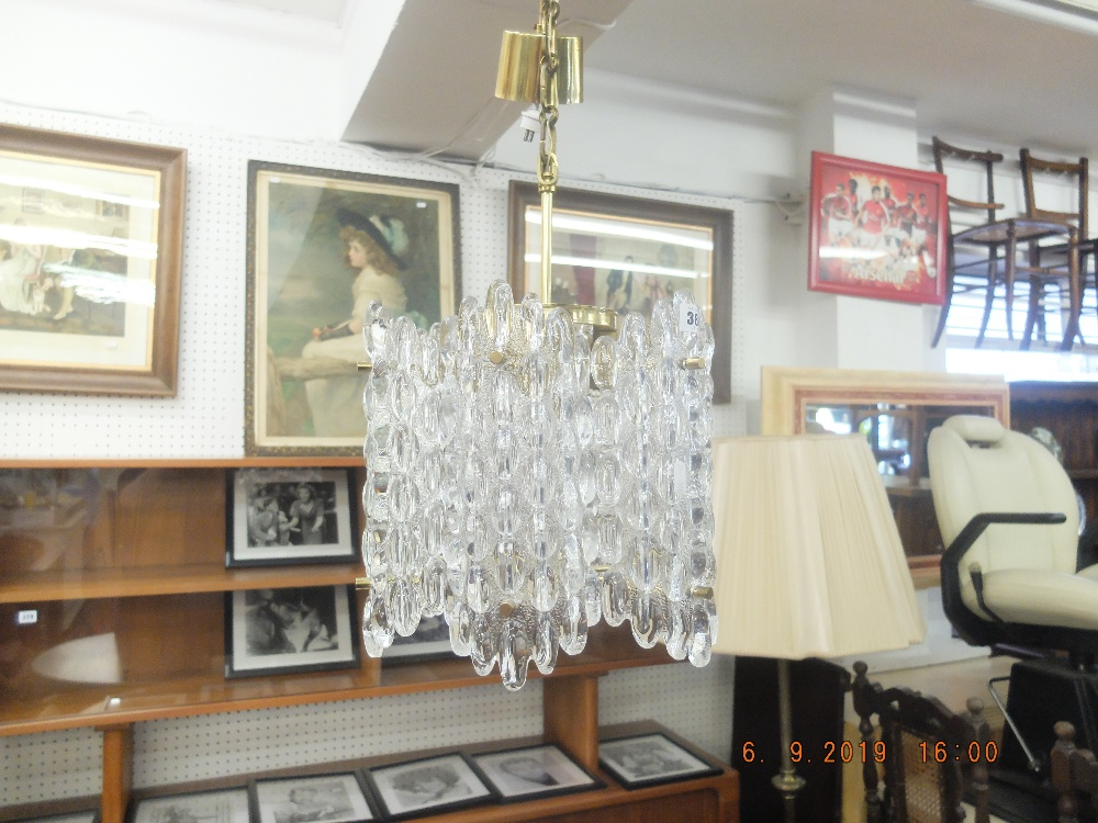 Lot 299 - A 1970's brass and crystal Orrefors chandelier designed by Carl Fagerlund height of light