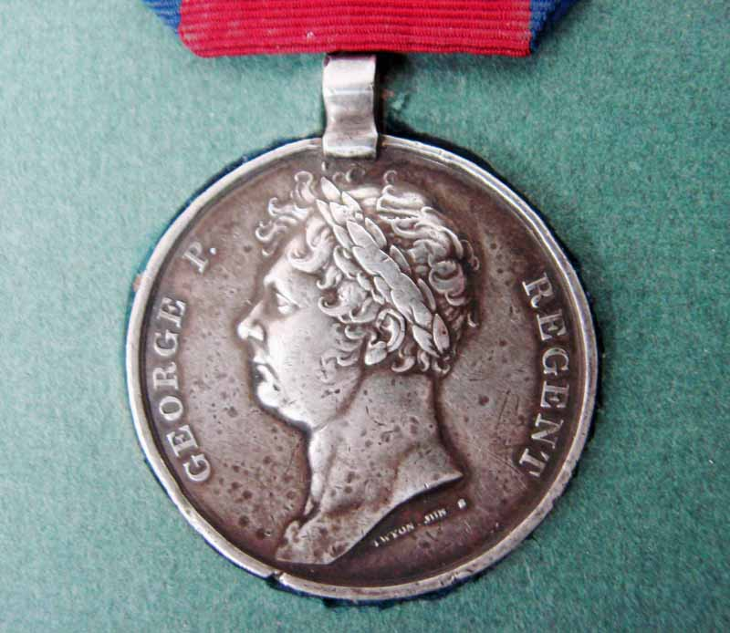 Lot 204 - A Wellington Waterloo Medal for June 18th 1815, struck by Thomas Wyon, stamped Lieut. Rochfort.