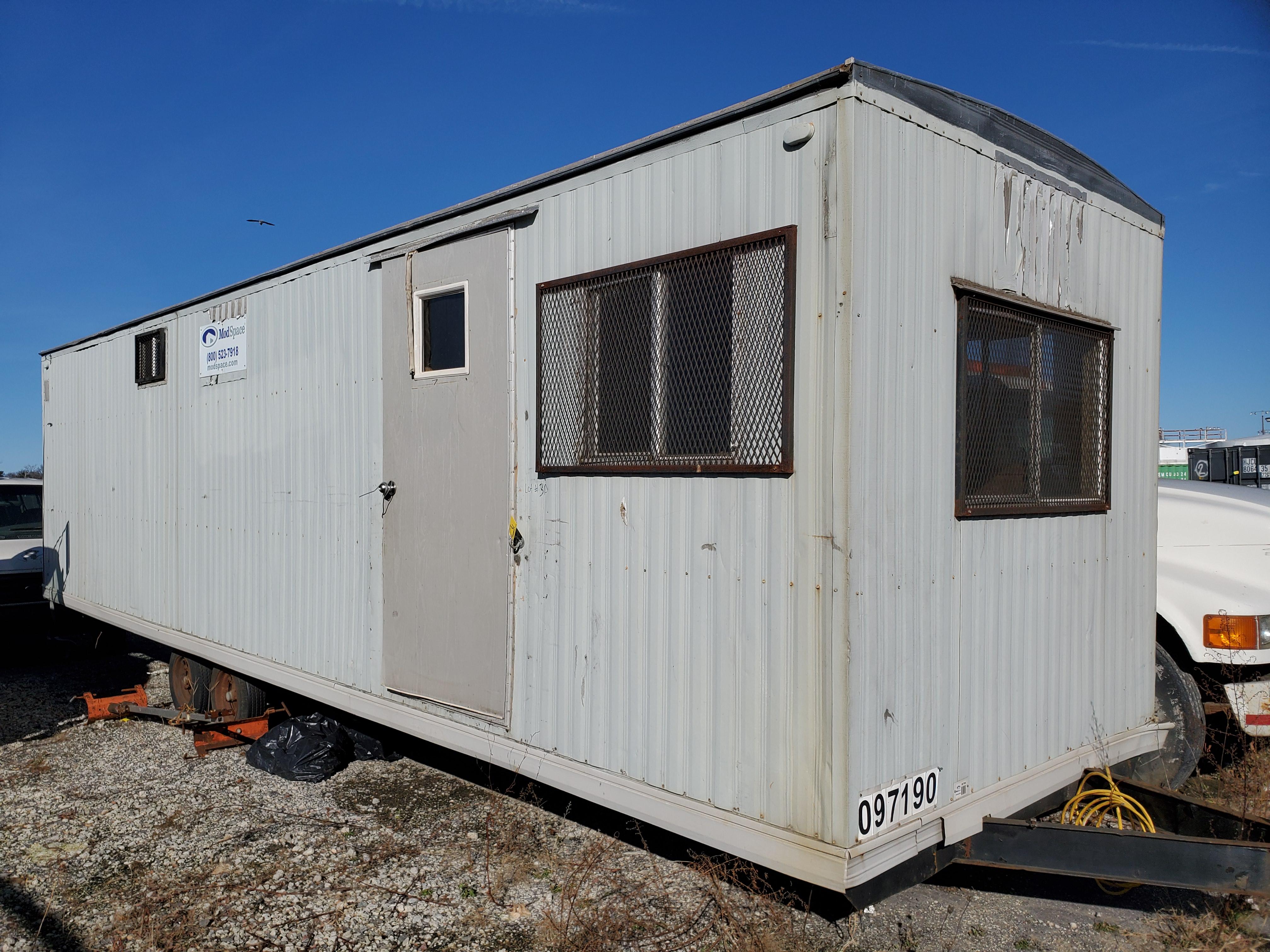 Lot 31 - 28' LONG MODULAR OFFICE TRAILER, DUAL AXLE, 2-DOOR, WINDOWS, ETC. [LOCATED @ 6 CANAL ROAD, PELHAM,