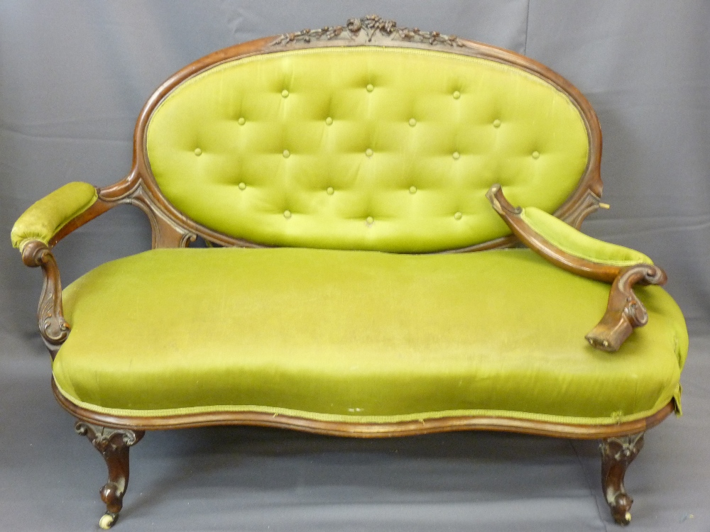 Lot 48 - WALNUT FRAMED SOFA with oval button backed upholstery with intricate carving and similar spoon-