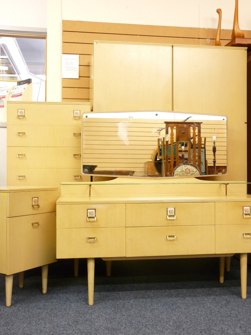 Lot 37 - RETRO BEDROOM SUITE comprising two door wardrobe, slim chest of drawers, bedside cabinet and a