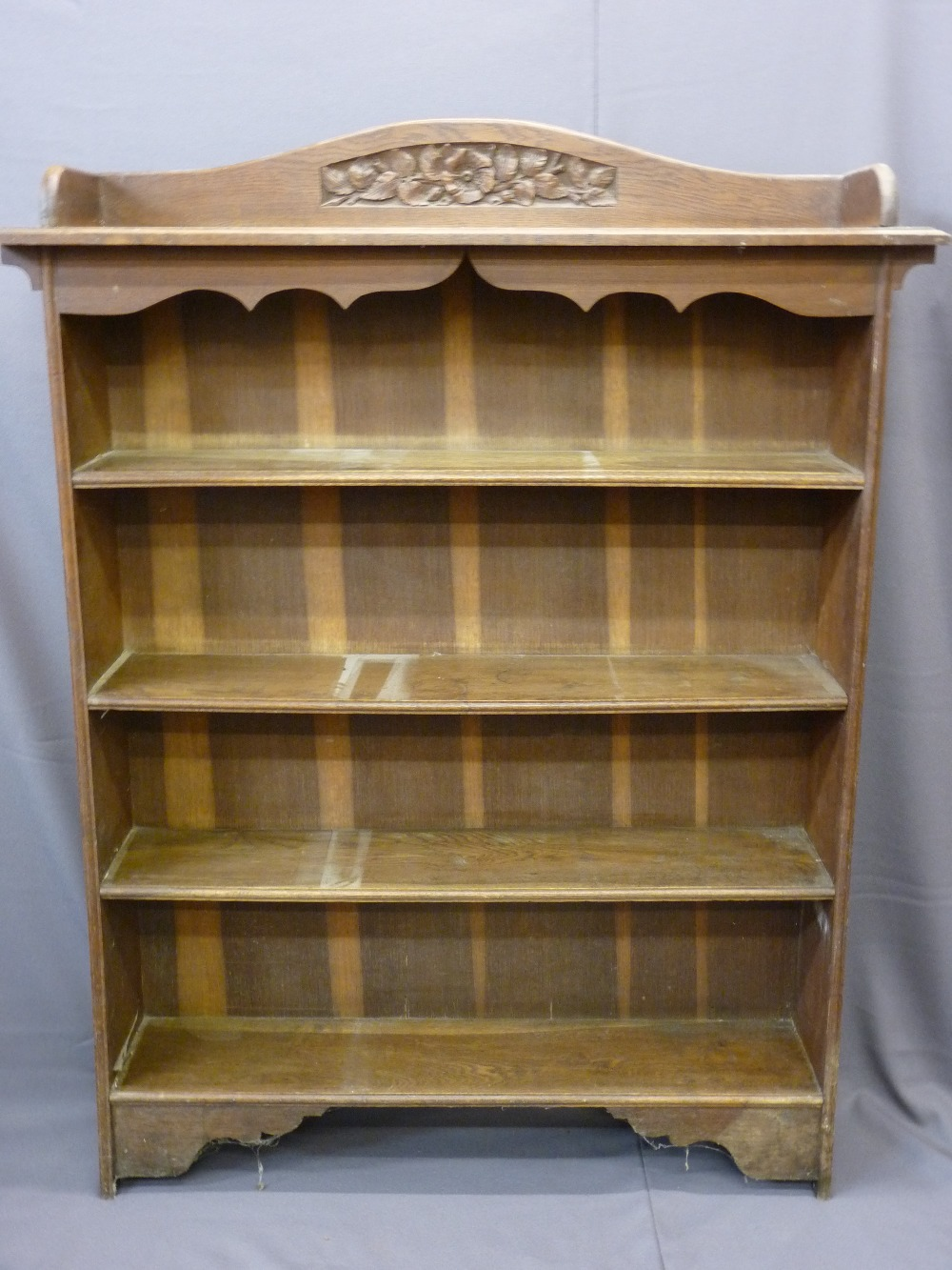 Lot 11 - ANTIQUE STYLE OPEN FOUR SHELF BOOK CASE with carved arched, rail back, 157cms height, 118cms