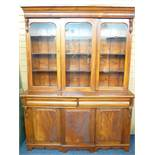 MAHOGANY CWPWRDD GWYDIR with three glazed panels over two base drawers and two flanking base