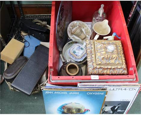A LARGE RED CRATE CONTAINING DOMESTIC COLLECTABLES to include; soda siphons, 12'' LP records, large cockerel decorated glass