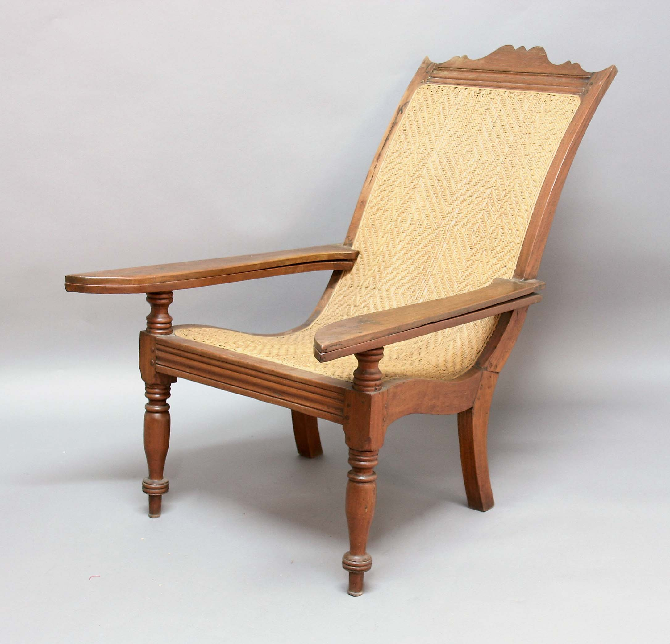 Teak plantation chair - Lot 2161 Colonial Teak Plantation Chair Early 20th Century With Caned Seat And