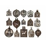 LOT WITH 15 LARGER SILVER AMULETS – INDIA 18th - 19th CENTURY Silver, some with remnants of cold