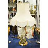 A brass and cut glass lamp with cream shade, base