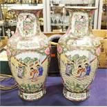 A pair of Oriental famille rose vases, panels depi