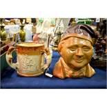 A large 19th century salt glazed jug, modelled as