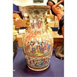 A large Chinese famille rose vase, moulded dog han