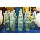 A group of glass Spendief Bros. pop bottles (12+)