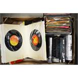 A selection of 45rpm records including Blondie, Ab