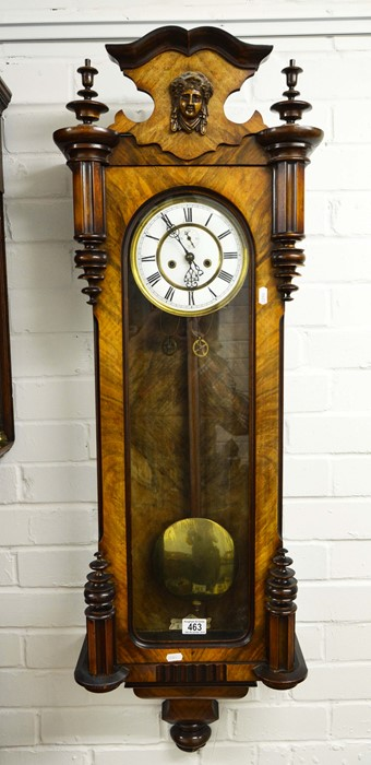 Lot 463 - A walnut cased Viennese style wall clock with mask pediment.