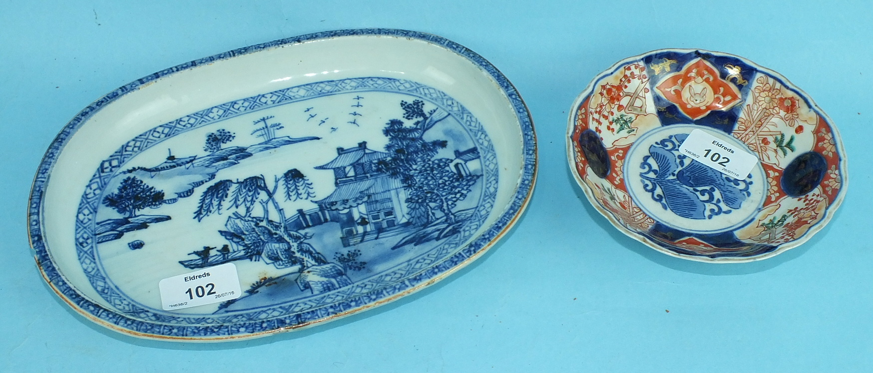 A late-18th century Chinese oval porcelain blue and white dish, (chip) and an Imari dish, (2).