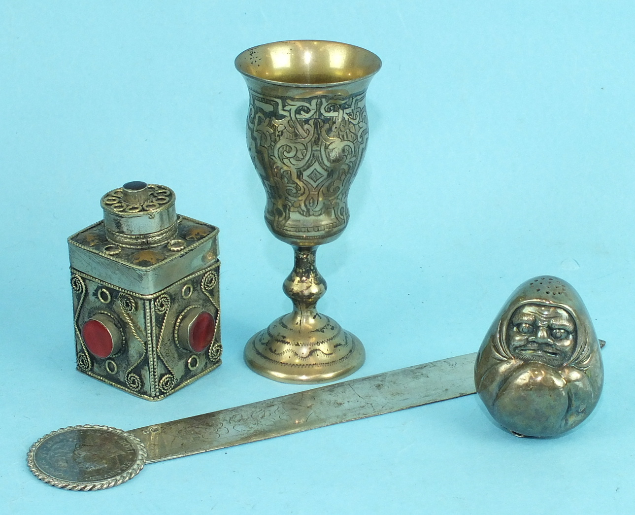 Lot 396 - A Russian silver gilt spirit cup with overall engraved decoration, 10cm high, a white metal letter