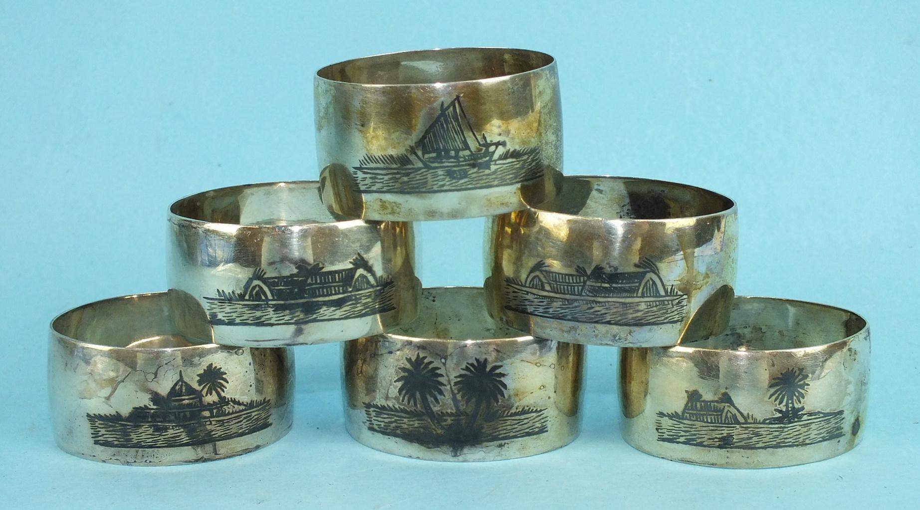 Lot 392 - A set of six Asian white metal napkin rings with niello-work decoration, ___3½oz.
