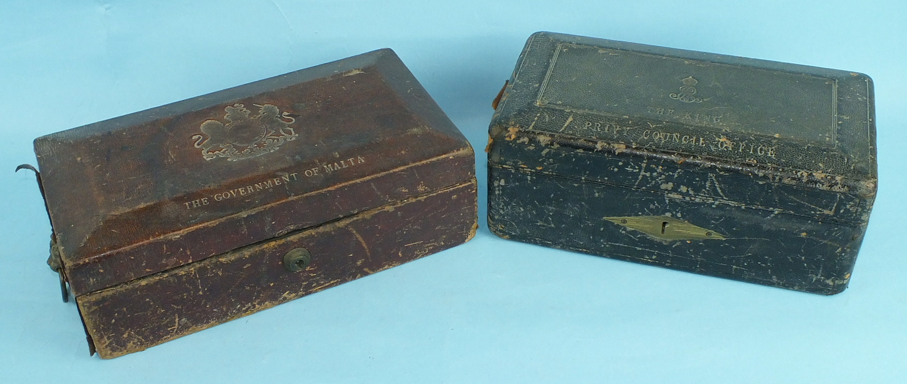 A leather-covered Privy Council Office document box, the tooled leather hinged lid with royal cipher