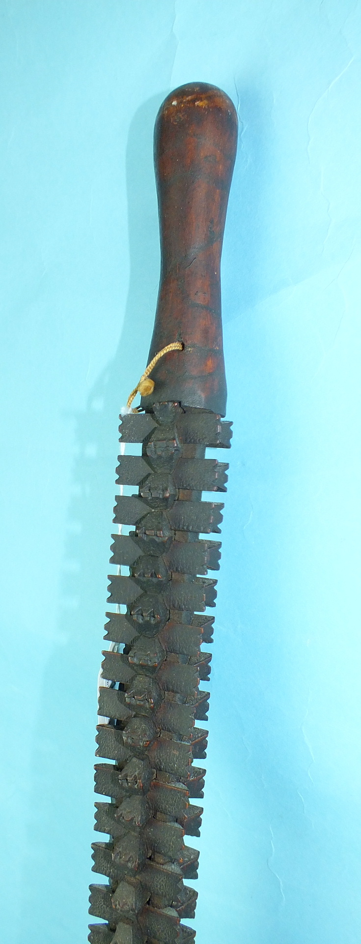 An African puzzle stick formed of individually-carved interlocking sections, 94cm long.