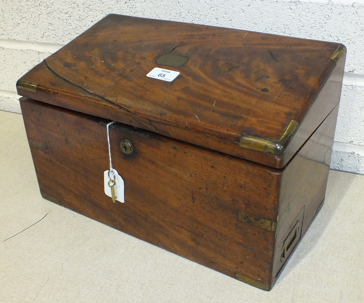 A brass-bound figured mahogany stationery box with hinged sloping lid, labelled 'F Waller, maker, 49
