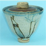 A studio pottery bowl and cover decorated with stylised landscapes and figures, signed 'E J