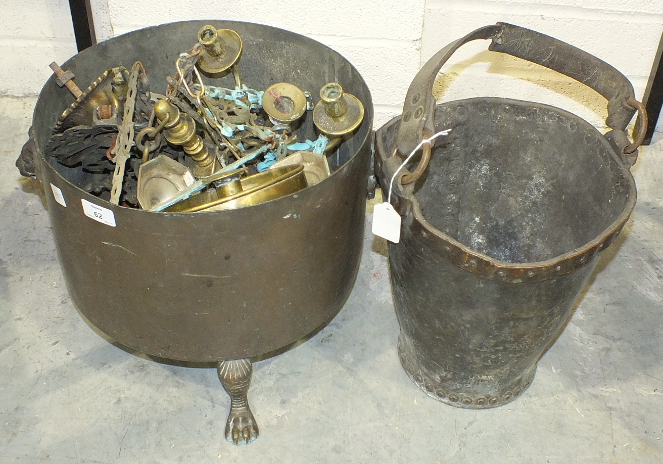 A 19th century copper-bound leather fire bucket (in poor condition), a copper coal bucket on three