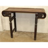 A Chinese hardwood altar table, 116cm wide, 85cm high.