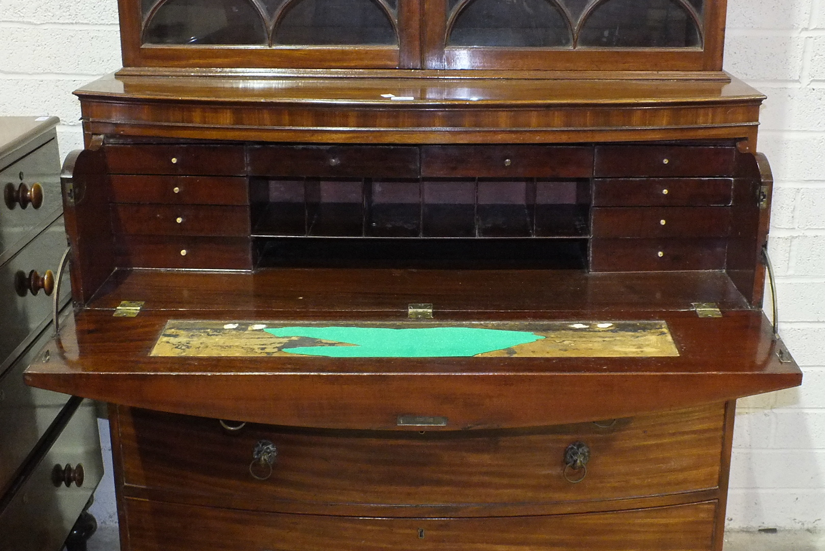 A George III mahogany bow-fronted secretaire bookcase, the moulded cornice above a pair of gothic - Image 2 of 2