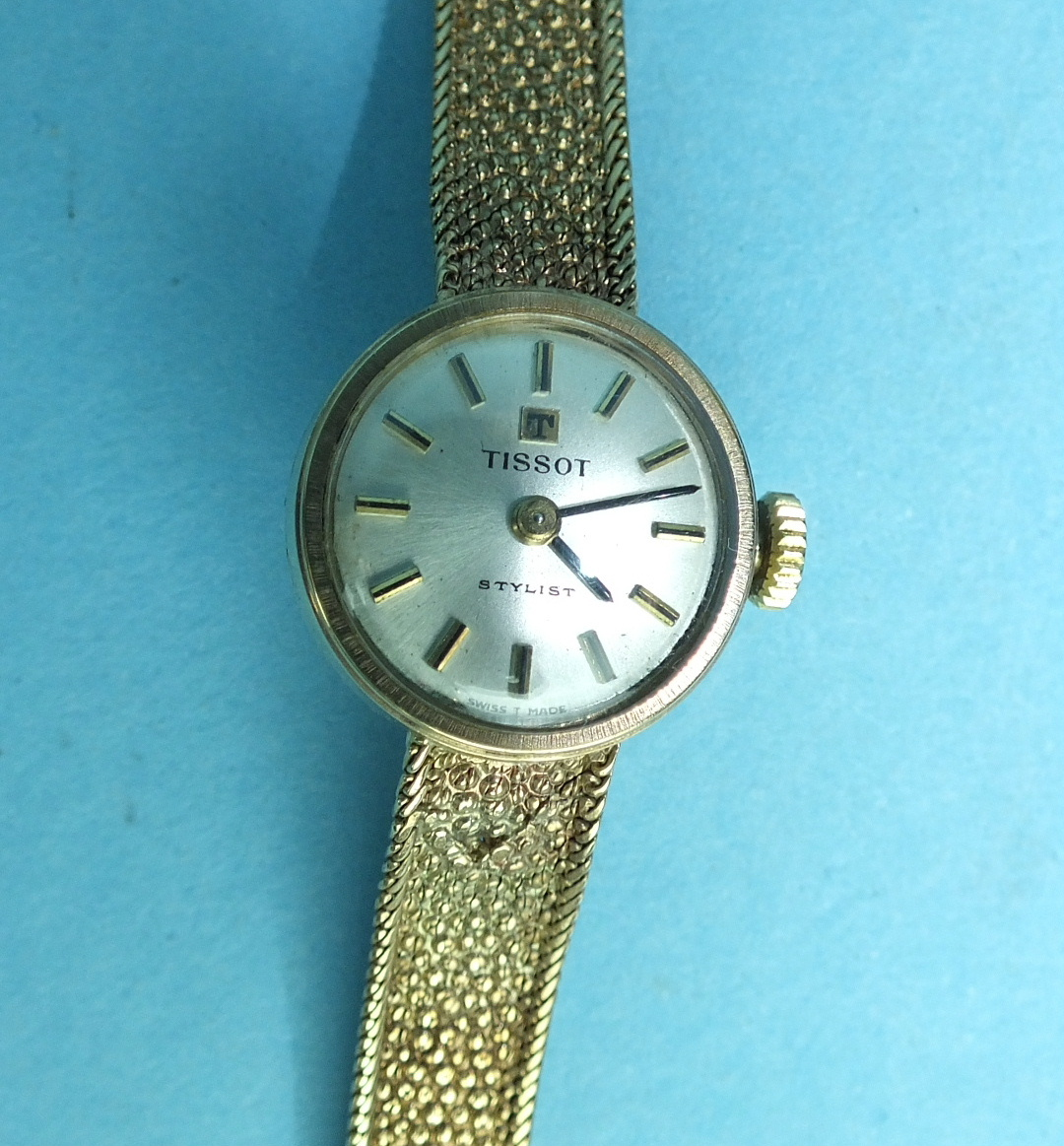 Lot 146 - Tissot, a ladies 'Stylist' 9ct gold wrist watch on gold mesh bracelet, total weight 16.5g, boxed.